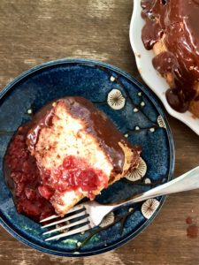 Sliced and Frosted Angel Food Cake with Strawberry Sauce